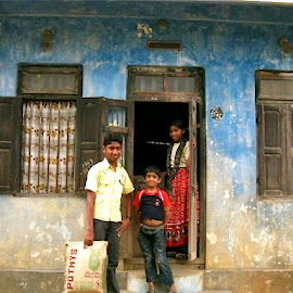 Family outside of home in India by Tyrell Heaton - Buildings & Architecture Homes ( home, family, india )