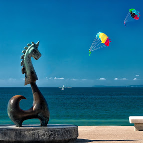 Protector of El Malecon by Jay Gould - Artistic Objects Other Objects ( blue sky, parachute toys, el malecon, beach, sea horse statue, puerto vallarta )
