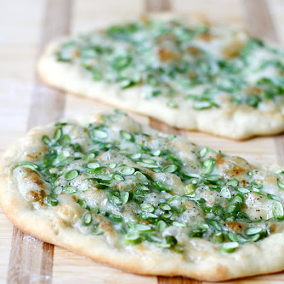Brie and Garlic Scape Pizza