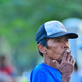 enjoy a cigarette by Achmad Ramadan - People Street & Candids