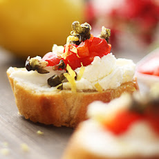 Creamy Goat Cheese Bruschetta with Roasted Red Peppers and Fried Capers