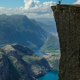 Preikestolen 604 by Elmo Ensio - Landscapes Mountains & Hills ( clouds, water, preikestolen, person, lysefjord, mountain, cliff, fjord )