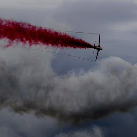smoke trails by Sandy Crowe - Transportation Airplanes ( red arrows, sky, display, aireplane, jet, smoke, selective color, pwc )