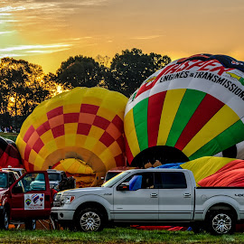 Inflating the Balloons by Carol Plummer - News & Events Entertainment ( hot air, trucks, transportation, balloons )