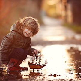 Puddle Muffin by Claire Conybeare - Chinchilla Photography - Babies & Children Toddlers ( england, rainy day, little boy, outdoors, bedfordshire, dunstable, puddle, fun, toddler, boat )