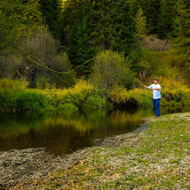 A Fisherman's Poise  by Dimitri Rebich - Sports & Fitness Watersports