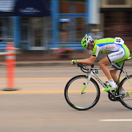 Home Stretch by James Grady - News & Events Sports ( lone rider, speed, sports, bicycle racing, motion, motion blur )