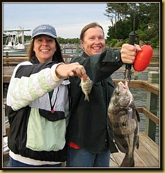 Tammy Atchison, of Winterville, NC, and Janie White, of Oak Island, with a 4 lb. black drum Janie caught in the Lockwood Folly River on cut shrimp.