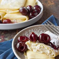 Ricotta Blintzes with Fresh Cherry Sauce