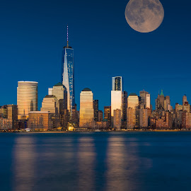 Downtown Manhattan skyline at sunset with Supermoon by Richard Cavalleri - City,  Street & Park  Skylines ( financial, skyline, freedom, manhattan, nyc, hour, new york, tower, blue, sunset, district, supermoon, downtown )
