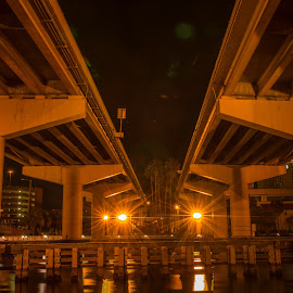 Golden Bridge by Lynn Wiezycki - Buildings & Architecture Bridges & Suspended Structures ( orange, light perspective, tampa, night, bridge )