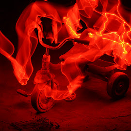 by Condie Friddle - Abstract Light Painting ( flames, tricycle, red, night shot, outside )