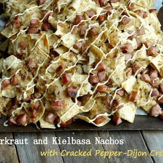 Sauerkraut and Kielbasa Nachos with Cracked Pepper-Dijon Cream