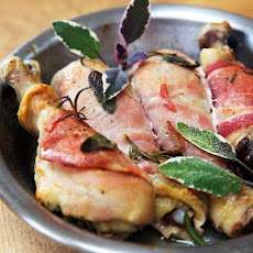 Chicken drumsticks wrapped in pancetta