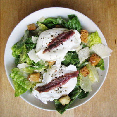 Caesar Salad Topped with Poached Eggs