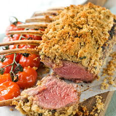 Maple and Dijon Marinated Herb-crusted rack of lamb with roasted tomatoes