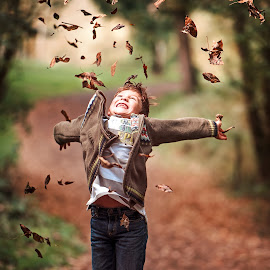 Fun in the fall by Shane McKenzie - Babies & Children Child Portraits ( park, happy, fall, kids, smile, leaves, portrait, jump,  )