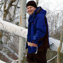 Curtis on a Tree. by Joerg Schlagheck - People Portraits of Men ( birch, winter, tree, forest, man, laughing.,  )