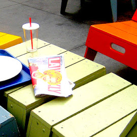 LA Weekly by Ronnie Caplan - Artistic Objects Furniture ( orange, blue, straw, chairs, green, tray, plate, yellow, plastic glass, newspaper, Urban, City, Lifestyle )