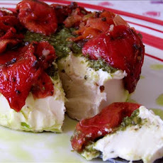 Brie Topped With Pesto and Sun-Dried Tomatoes