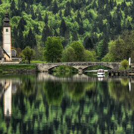 Church at the lake Bohinj by Gregor Skoberne - Landscapes Waterscapes ( reflection, church, slovenia, forest, lake, waterscapes, landscapes, spring, bohinj )