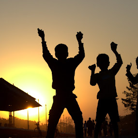 Joy de vivre by Raj Mushahary - Babies & Children Children Candids ( jumping, bodoland, silhouette, joy, joy de vivre, kids, shadow dancing, udalguri, assam, praise the lord, vivre, happy, sunset, boys, three, india, raised hands, btc )