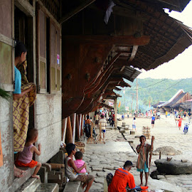 Traditional Village and Houses in Nias by Leong Jeam Wong - Buildings & Architecture Homes ( timber, traditional, attap, people, log )