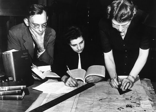 Bill Burke and Jane Mull, members of the Committee on the Protection of Cultural Treasures in War Areas at the ACLS, working at the Frick Art Reference Library with Gladys Hamlin, draftswoman, on a map of Paris.