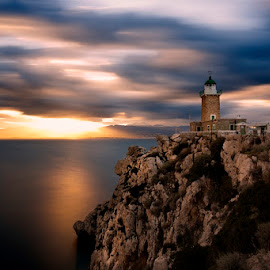 Lighthouse... by Frank Kotsos - Landscapes Travel ( lighthouse greece loutraki sea clouds sky light blue sunset, wallpaper )