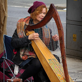 Harping on about something by Kevin Ward - People Street & Candids