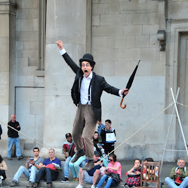 Unedited - Street Performer in London by Julie Josey - People Musicians & Entertainers ( london, comedy, rope, umbrella, unedited, performer, actor, people,  )
