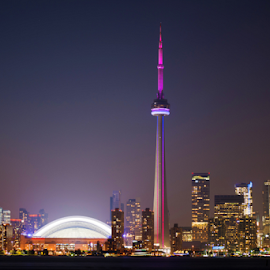 CN Tower and Toronto Skyline by Robert Machado - Landscapes Travel ( skyline, harbor, centre, toronto, silhouette, travel, architecture, cityscape, glow, city, center, sky, light, financial, highrise, roger centre, canada, twilight, lake, dusk, destination, landmark, cn, horizontal, stadium, canadian, waterfront, panoramic, reflection, colorful, roger, landscape, business, panorama, modern, skyscraper, nighttime, cn tower, evening, downtown, tall, water, building, ontario, urban, tower, color, blue, night, sunrise )