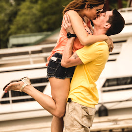 strength in love by Douglass Kilgore - People Couples ( kick, kissing, holding, boats, male, dock, kiss, female, woman, lift, summer, couple, man, river )