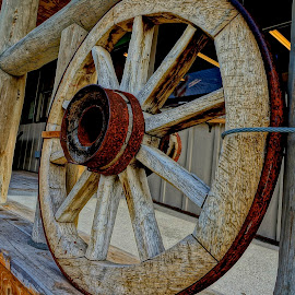 Wyoming Wheel by Barbara Brock - City,  Street & Park  Street Scenes ( old west town, wood railing, wyoming street, wooden sidewalks, wagon wheel railing )