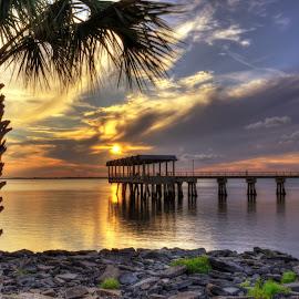 Pier at Sunset by Greg Mimbs - City,  Street & Park  City Parks ( clouds, water, crabbing, georgia, ocean, greg mimbs, coast, fishing pier, palm tree, sky, sunset, pier at sunset, fishing, jekyll island, rocks,  )