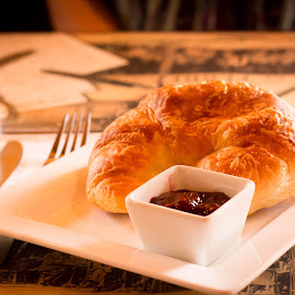 Un croissant avec confiture framboise. by Alex Harris - Food & Drink Plated Food ( foodie, plated food, food photography, french, croissant )