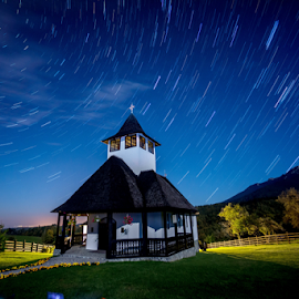 by Tudor Migia - Buildings & Architecture Places of Worship ( spruce, sky, church, grass, stars, monastery, romania, night, startrails, bran )