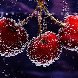 More cherries in water  by Roman Kolodziej - Food & Drink Fruits & Vegetables ( water, fresh, oxygene, fruits, bubbles, healthy, cherries, Food & Beverage, meal, Eat & Drink )