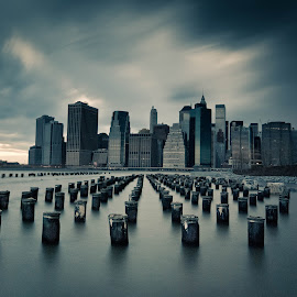 Gotham by Alicia Petgrave - City,  Street & Park  Skylines ( skyline, east river, manhattan, long exposure, cityscape, new york city, pilings, downtown, brooklyn )