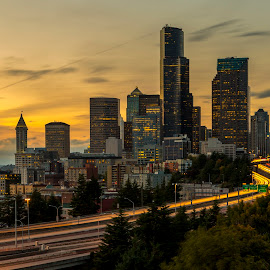 Driving Through Seattle  by Bill Kuhn - City,  Street & Park  Skylines ( drivers, skyscapers, skyline, puget sound, i-5, cityscape, dusk, city, tower, traffic, offices, seattle, sunset, buildings, brake lights, light trails, long exposure, freeway, downtown )