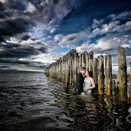 Passion at sea by Thomas Gudbrandsen - Wedding Bride & Groom ( clouds, water, wedding, ocean, bride, groom, skies, trashthedress )