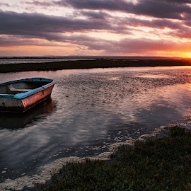 River Sunset by Rick Janse Van Rensburg - Landscapes Sunsets & Sunrises ( water, clouds, orange, ripples, sunset, seascape, boat, river, gamtoos )