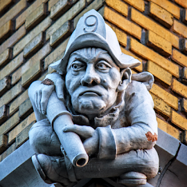 Fireman Gargoyle by Kevin Anderson - Buildings & Architecture Architectural Detail ( firefighter, fire station, kansas city, harris, prairie school, nrhp, william e., national register of historic places, fireman, gargoyle, tudor revival, kansas, 85001982 )