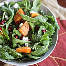 Persimmon and Arugula Salad with Pomegranate Seeds, Mint, and Feta