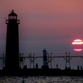 Grand Sunset by Christine Weaver-Cimala - Landscapes Sunsets & Sunrises ( michigan, grand haven, nature, silhouette, sunset, lighthouse, lake, sun )