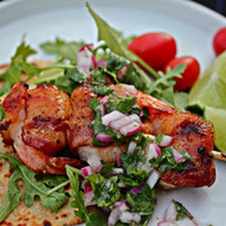 Grilled, Bacon-Wrapped Shrimp with Arugula and Red Onion Relish