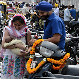 happiness by Vidur Jyoti - City,  Street & Park  Street Scenes ( sharing, couple, scooter, smiling, newborn )