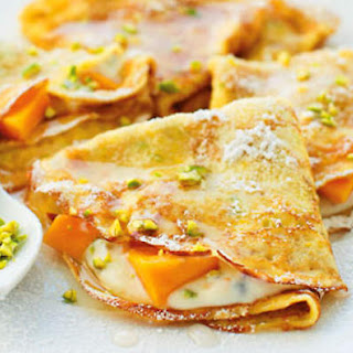 Ricotta-filled Crêpes With Mango And Rose Syrup