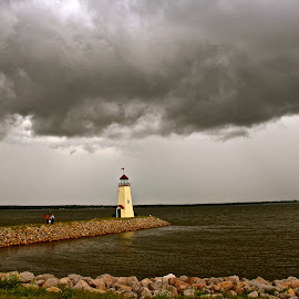 Dark Storm Clouds Over Lighthouse by Kathy Suttles - Landscapes Weather