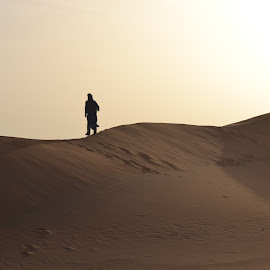 Walking across the Dunes by Collette Hurn - Landscapes Deserts